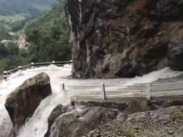 The Most Horrifying Road On Earth Has Two Waterfalls To Drive Through