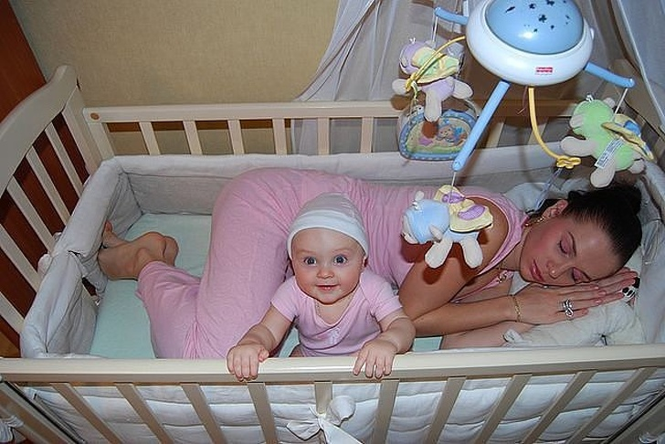 baby and mother in the crib