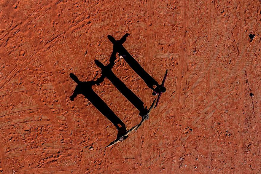 Three Figures In The Jordan Desert Near Wadi Rum