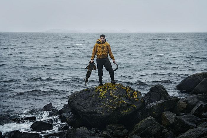 fisherman on a rock