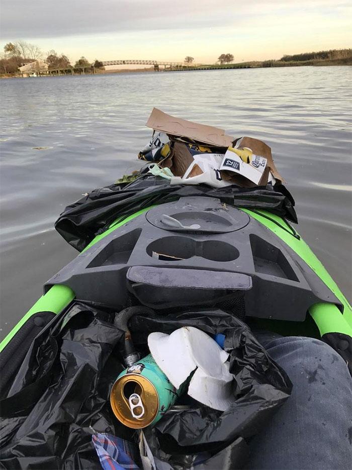 kayak filed with trash