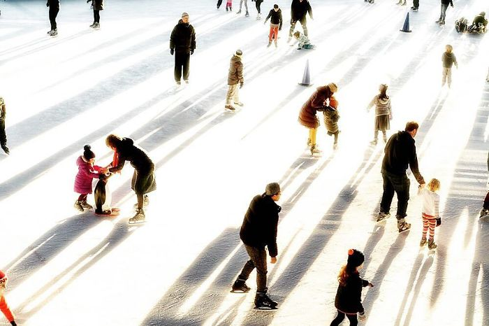 Families glide on an ice rink in Brooklyn, New York's Prospect Park on an unseasonably warm January day