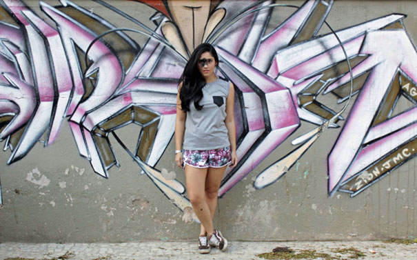 Mariana Mendes in front of drafty wall