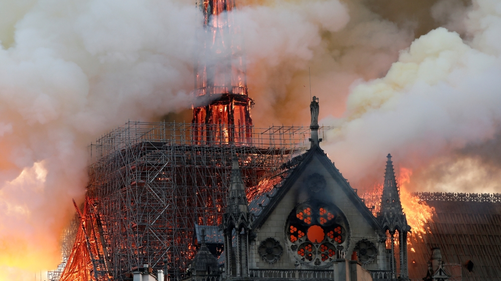 iconic structure in central Paris in flames
