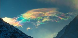 Stunning Iridescent Clouds Captured In Rare Sighting on Siberian Peak