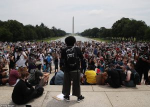 demonstrators gathered in front of the Lincoln Memorial