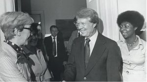 The former president is having a friendly chat with some women leaders