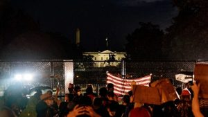 Protesters approached a newly built chain-link fence in front of the White House